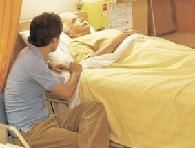 Kind man visiting an old man in hospital