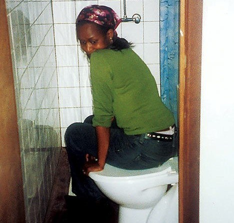 immaculee in toilet where she lived for 90 days with 7 other women